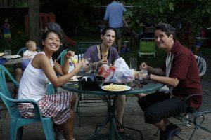 group eating in backyard